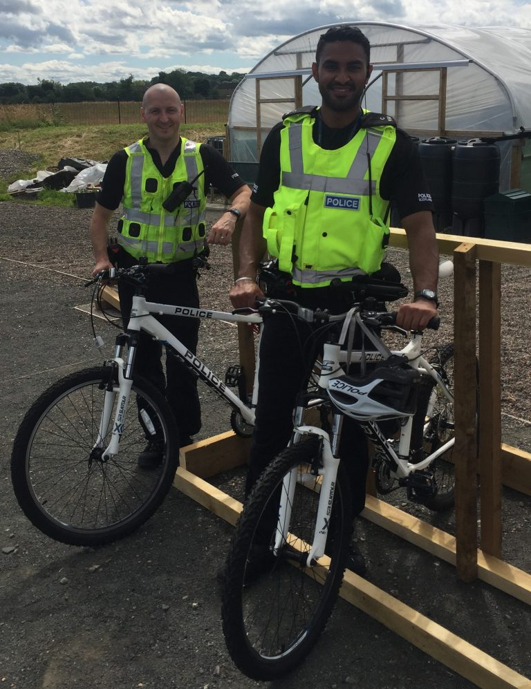 PC Chris Smith (left) and PC Manveer Sangha (right) visit Braehead Community Garden.
